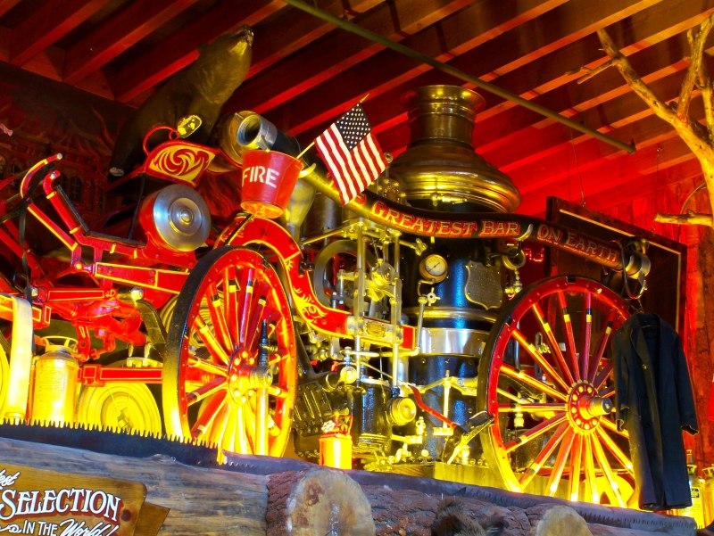 Fire Steam Water Pumper - The Fire Steam Water Pumper above the bar was built by the American La France Company in 1907 and sold to the City of Waco, Texas. Of course they want it back, but it belongs to the citizens of Carson City now...